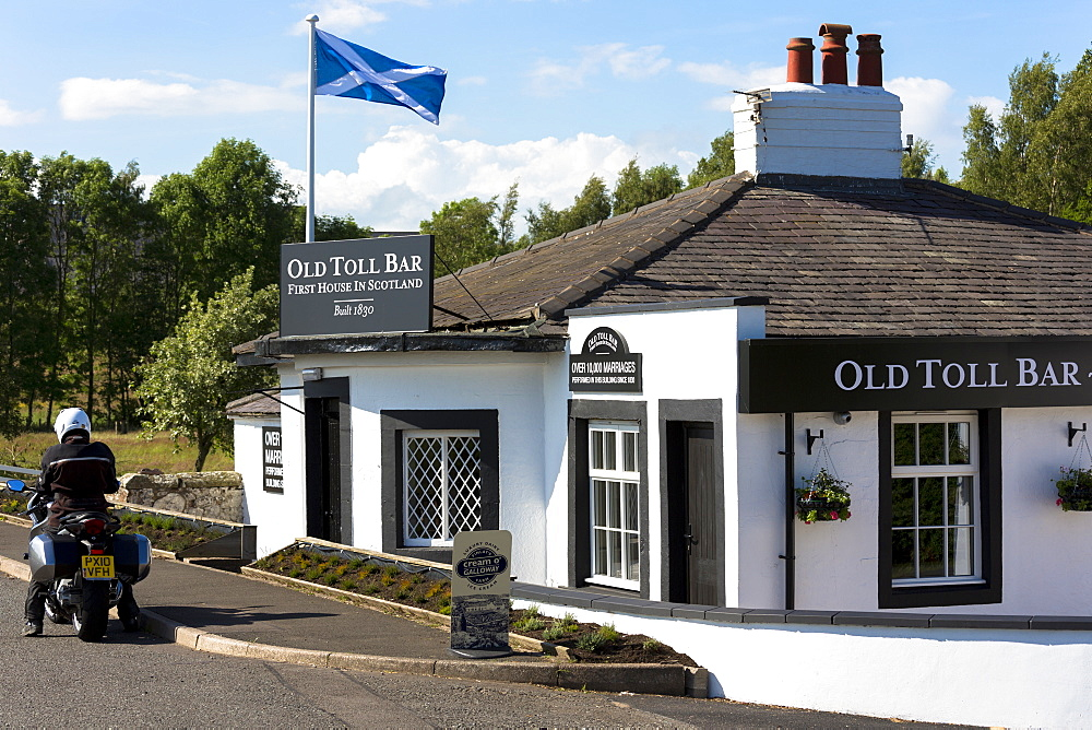 Scottish flag, the Saltire, on the First House in Scotland on the Scottish/English border at Gretna, Scotland, United Kingdom, Europe