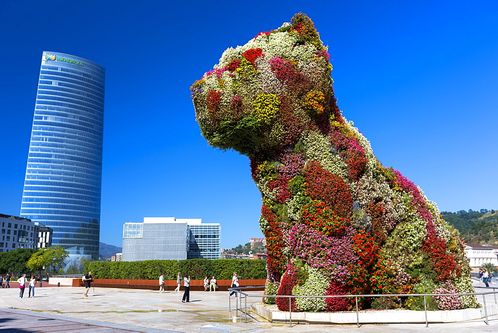Puppy flower feature floral art in dog form by Jeff Koons at Guggenheim Museum and Iberdrola Tower, Bilbao, Basque Country, Euskadi, Spain, Europe