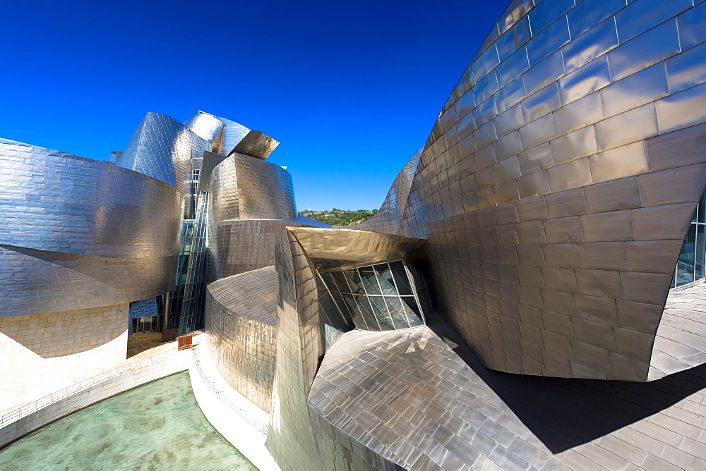 Architect Frank Gehry's Guggenheim Museum futuristic architectural design in titanium and glass at Bilbao, Basque country, Euskadi, Spain, Europe