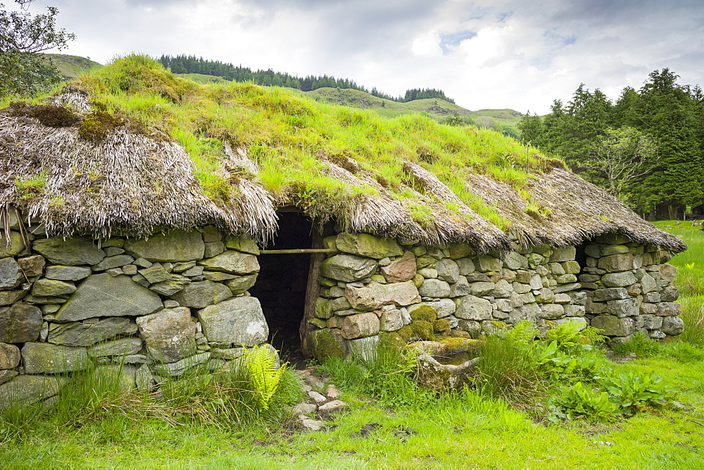 Thatched cottage old stone home at Auchindrain Highland farming township settlement and village folklore museum at Furnace near Inveraray in the Highlands, Scotland, United Kingdom, Europe