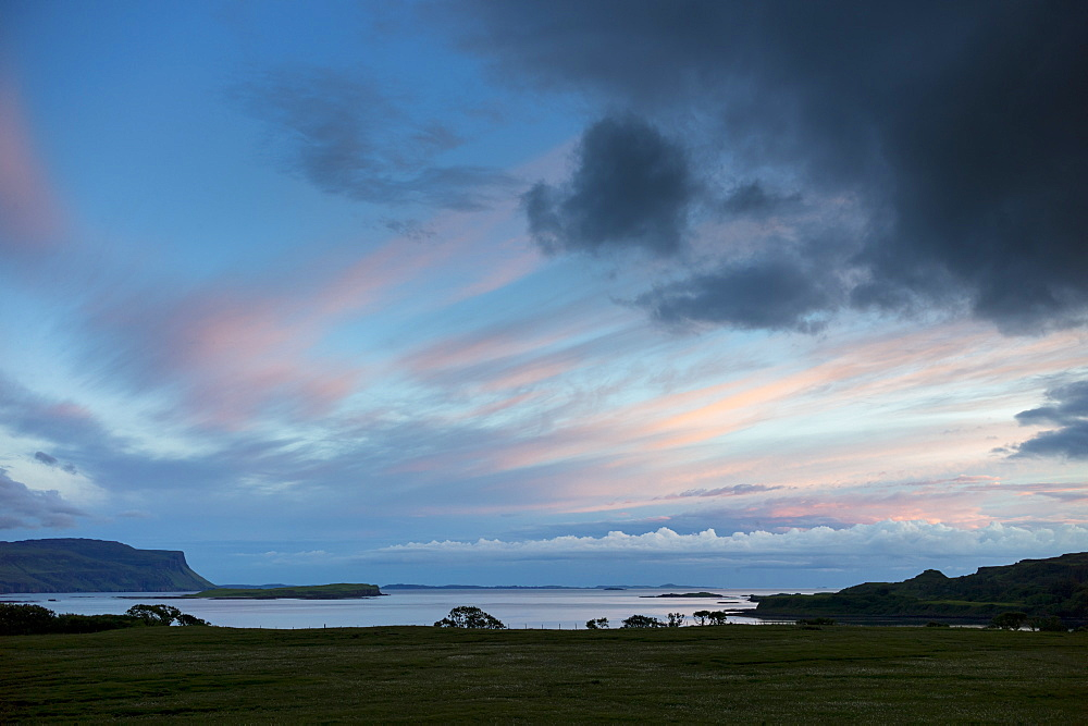 Panoramic sky of pink and blue pastel colours over Loch Na Keal at sunset on the Isle of Mull, Inner Hebrides, Western Isles, Scotland, United Kingdom, Europe