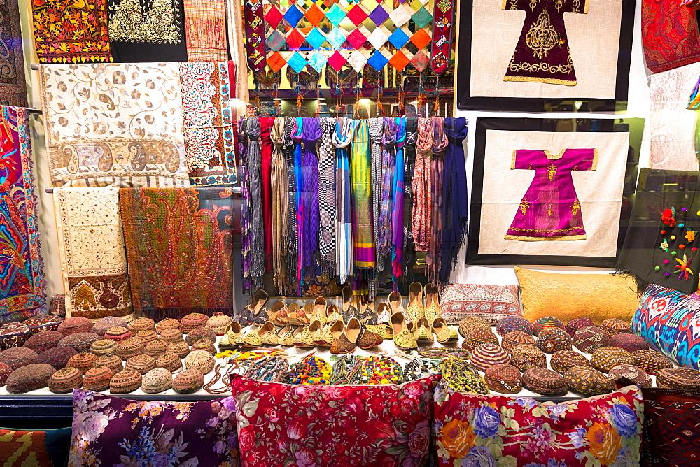 Turkish clothing including scarves, kufi (Muslim skullcap) taqiyah tagiya and cushions in Arasta Bazaar, Sultanahmet, Istanbul, Turkey, Europe