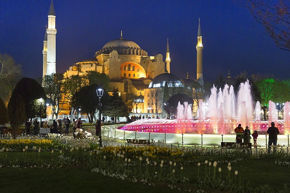 Floodlit domes and minarets of Hagia Sophia mosque museum, UNESCO World Heritage Site, Atmeydani Hippodrome fountain in Istanbul, Turkey, Europe