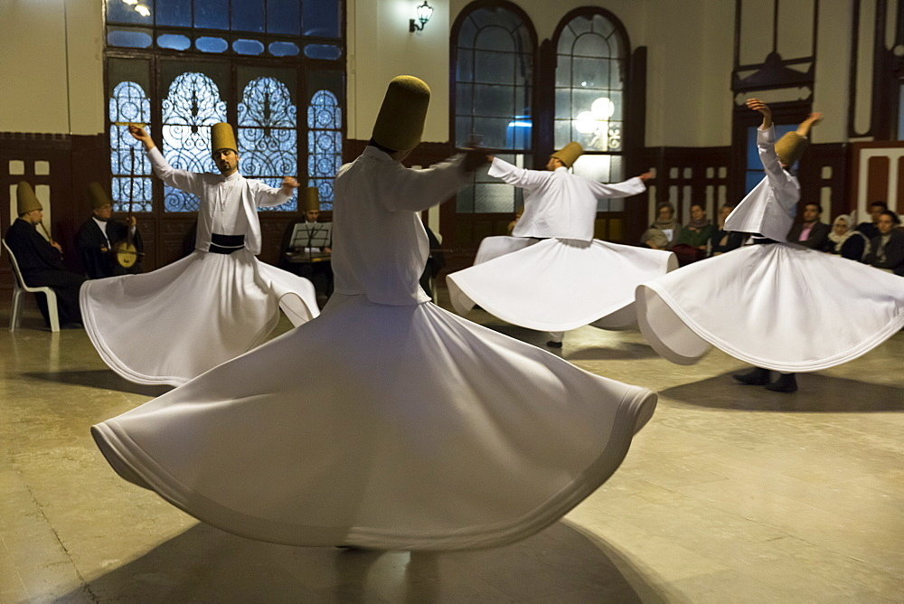 Tourists at Whirling Dervish ayin music performance (Mevlevi Sema) a spiritual ceremony performed by whirling dervishes, Istanbul, Turkey, Eurasia