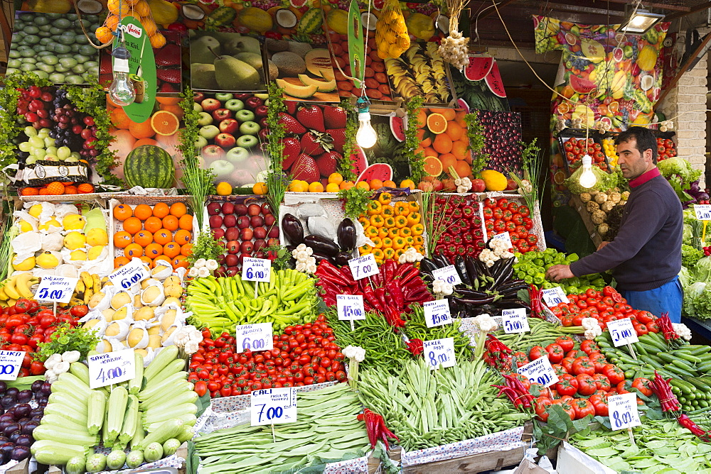 Shopkeeper with fresh fruit and vegetables with Turkish lira prices at food market Kadikoy, Asian Istanbul, Turkey, Asia Minor, Eurasia - 1161-8589