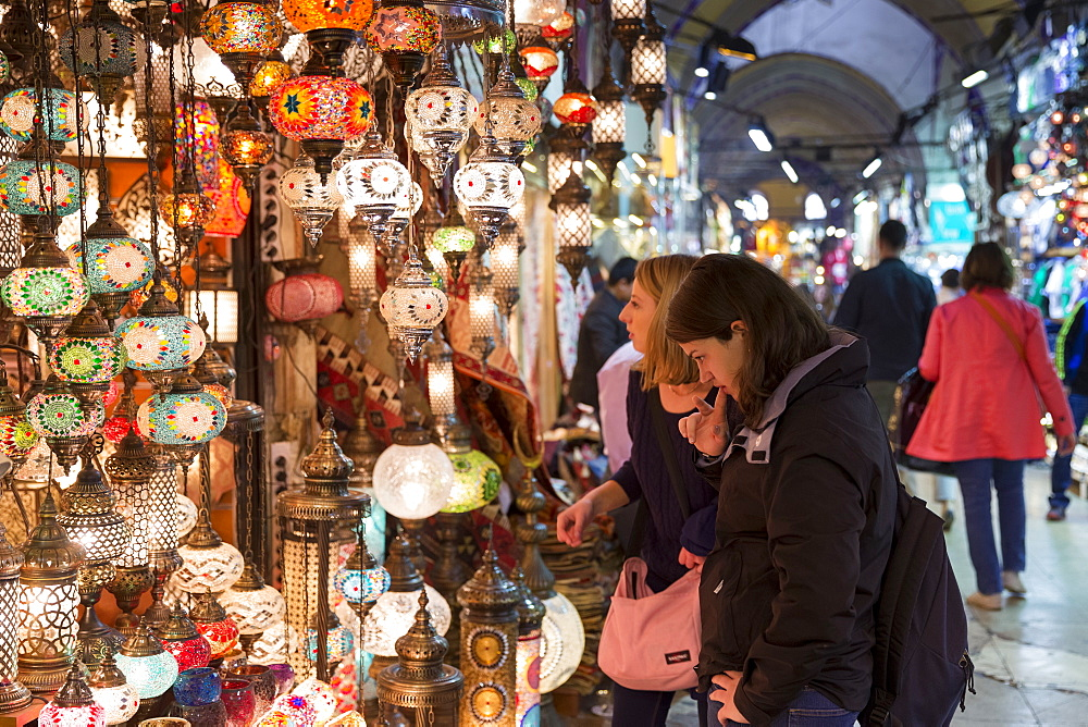 Tourists shopping for lamps inside The Grand Bazaar (Great Bazaar) (Kapali Carsi), Beyazi, Istanbul, Turkey, Europe