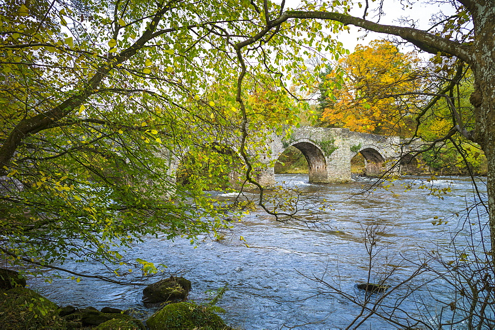 Atmospheric scene with ancient LLangynidr Bridge, a road bridge with arches over the River Usk, Brecon Beacons, Powys, Wales, United Kingdom, Europe
