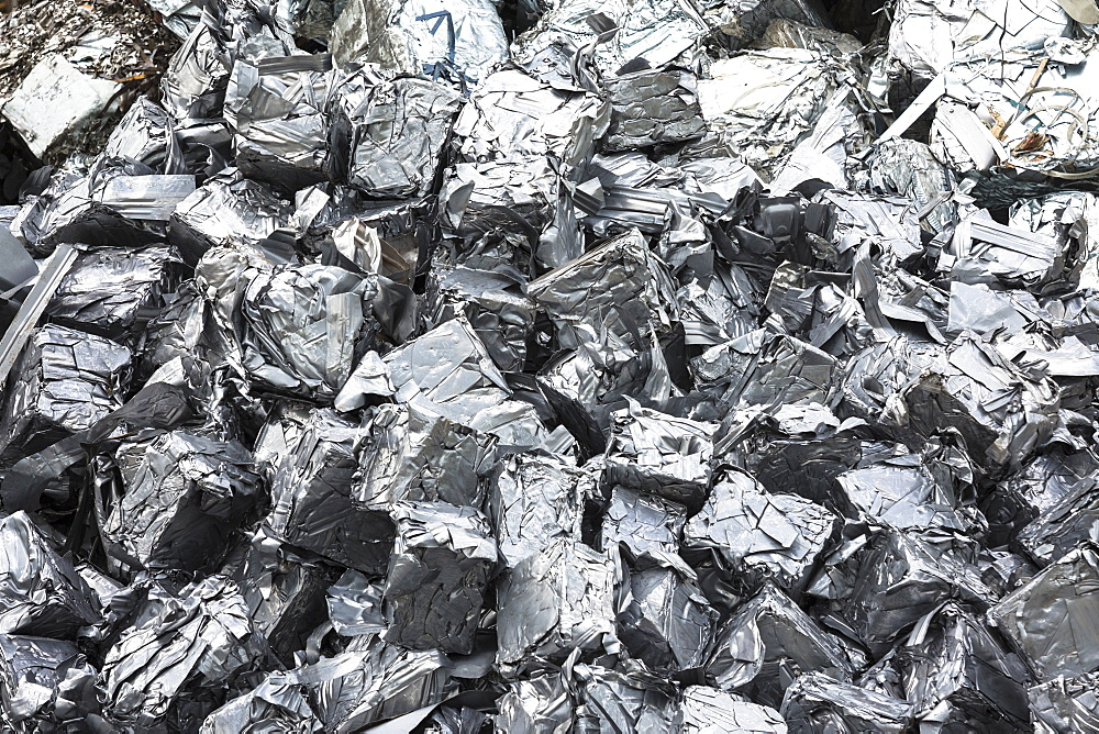 Recycling scrap metal dealer, dealing in ferrous and non-ferrous metals, compacted into cubes to stop environmental pollution, England, United Kingdom, Europe