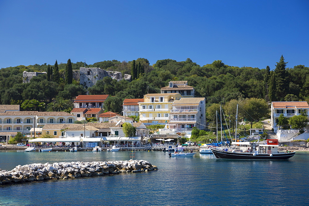 Spectacular beach resort and harbour of Kassiopi with blue sky and turquoise Ionian Sea, Corfu, Ionian Islands, Greek Islands, Greece, Europe - 1161-8655