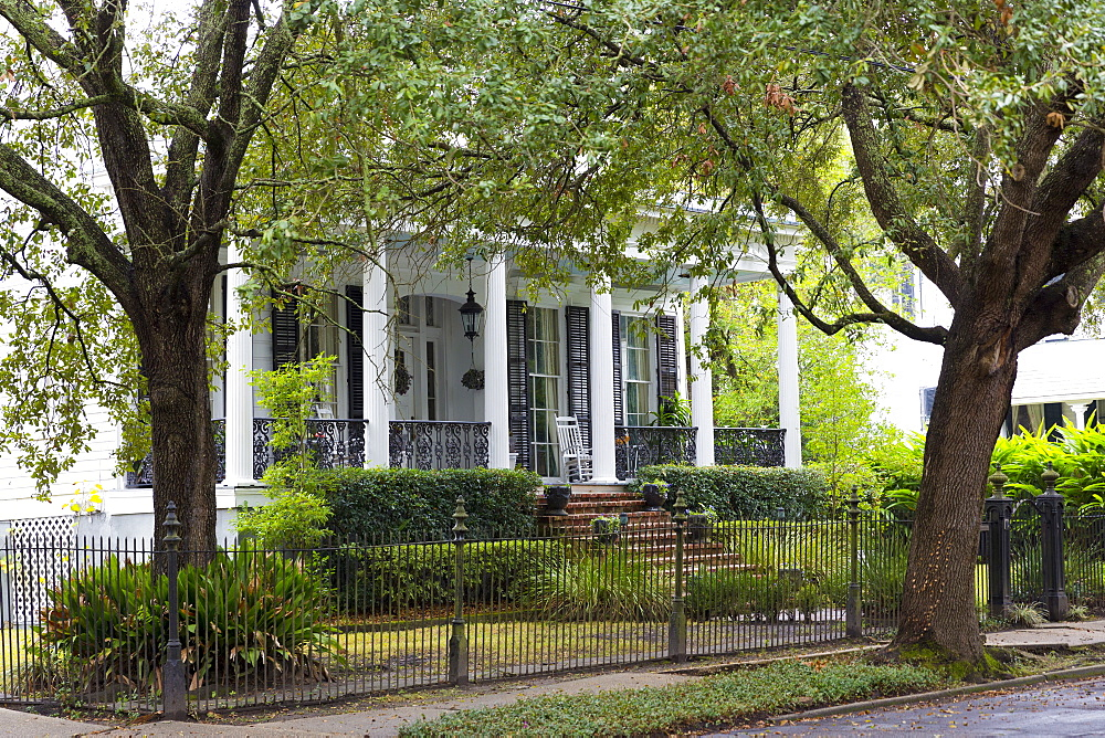 Traditional grand mansion house with columns in the Garden District of New Orleans, Louisiana, United States of America