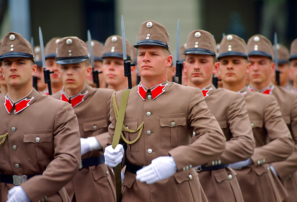 Hungarian Soldiers in their beige and red uniforms marching in Budapest, Hungary