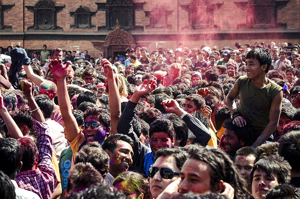 A crowd gathers in Basantapur Durbar Square to celebrate the Holi festival, Kathmandu, Nepal, Asia  - 1163-93