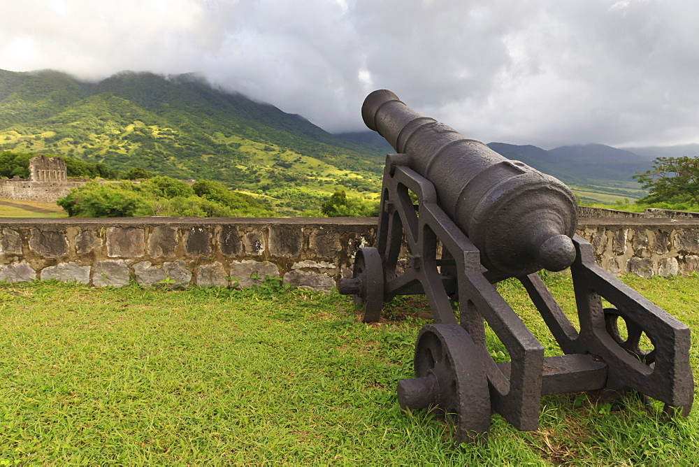 Cannon and green hills, Brimstone Hill Fortress, St. Kitts, St. Kitts and Nevis, West Indies, Caribbean, Central America