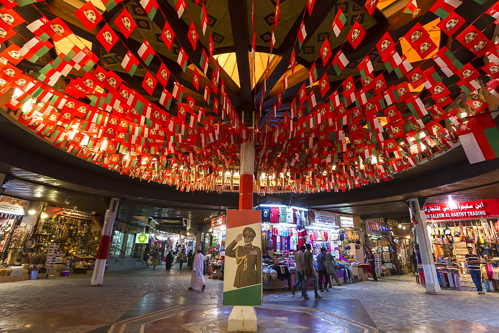 Flags and Sultan's portrait decorate Mutrah Souq for Oman National Day, 18 November, Muscat, Oman, Middle East