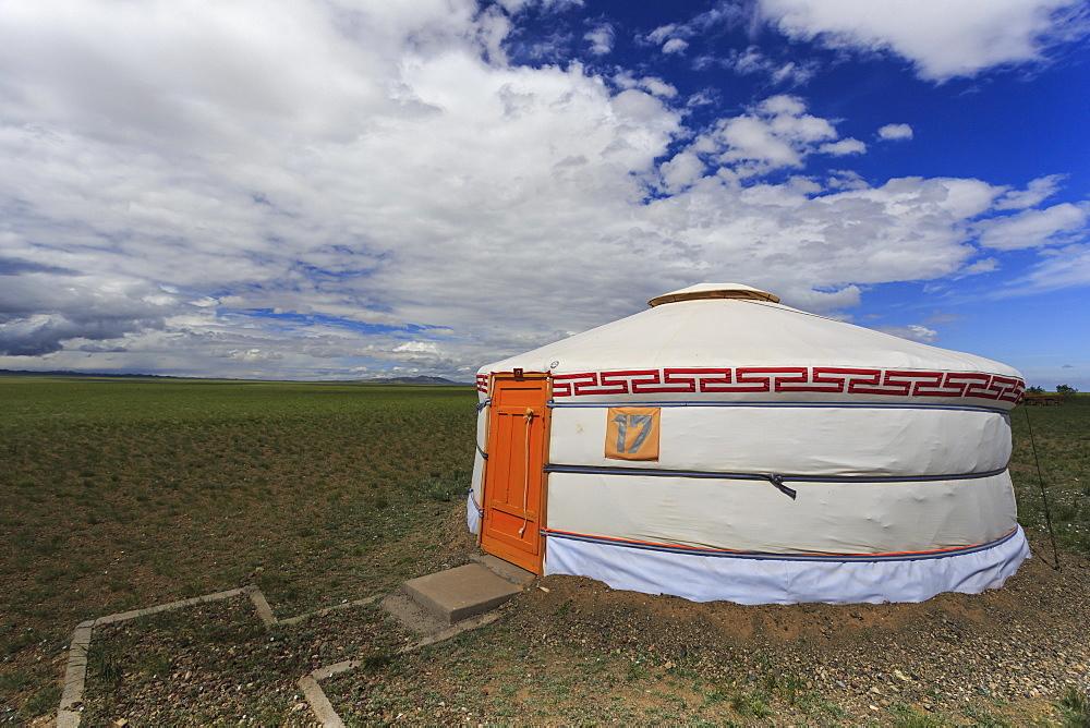 Tourist ger amidst expansive Gobi landscape under a blue sky, Gurvan Saikhan National Park, Tsagaan Tolgol, Mongolia, Central Asia, Asia