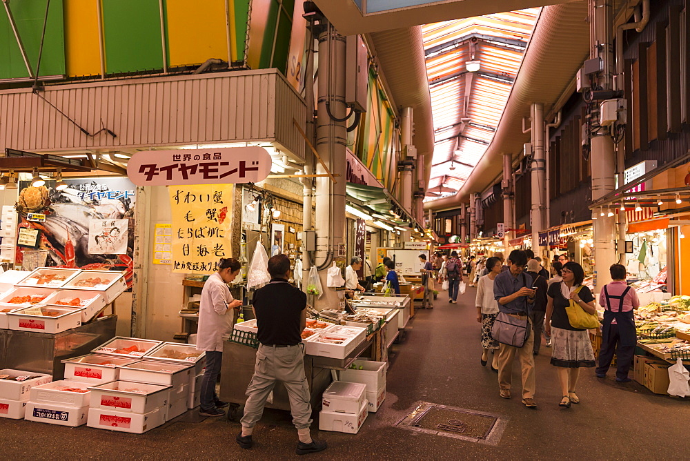 Shoppers at Omicho fresh food market, busy and colourful network of covered streets lined by stalls, Kanazawa, Japan, Asia