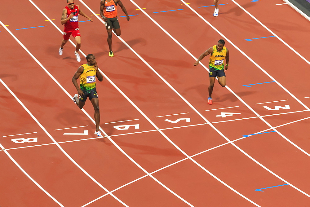 Usain Bolt crosses line with finger to lips, looks at Yohan Blake, Men's 200m final, London 2012, Olympic Games, London, England, United Kingdom, Europe