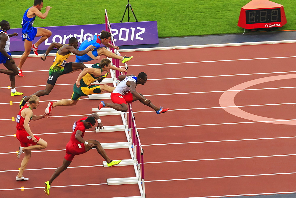 Competitors in Men's 110m hurdles semi-final clear hurdles, London 2012 Stadium, Summer Olympic Games, London, England, United Kingdom, Europe