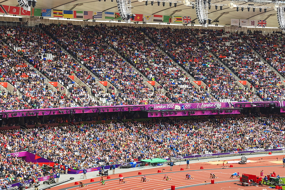 Crowds in the stands of Olympic Stadium, with runners on the starting blocks, London 2012, Summer Olympic Games, London, England, United Kingdom, Europe
