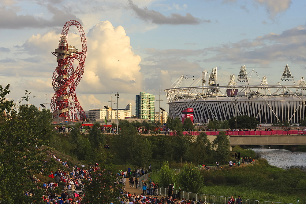Crowds in the Olympic Park in early evening, with Orbit and Olympic Stadium, London 2012, Summer Olympic Games, London, England, United Kingdom, Europe