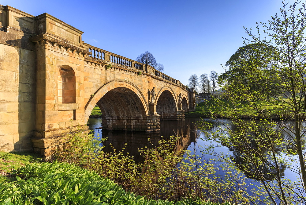 Sandstone bridge by Paine over River Derwent on a spring morning, Chatsworth Estate, home of Duke of Devonshire, Derbyshire, England, United Kingdom, Europe
