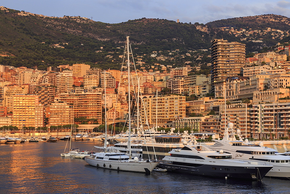 Yachts in the glamorous Port of Monaco (Port Hercules) at sunrise, from the sea, Monte Carlo, Monaco, Mediterranean, Europe