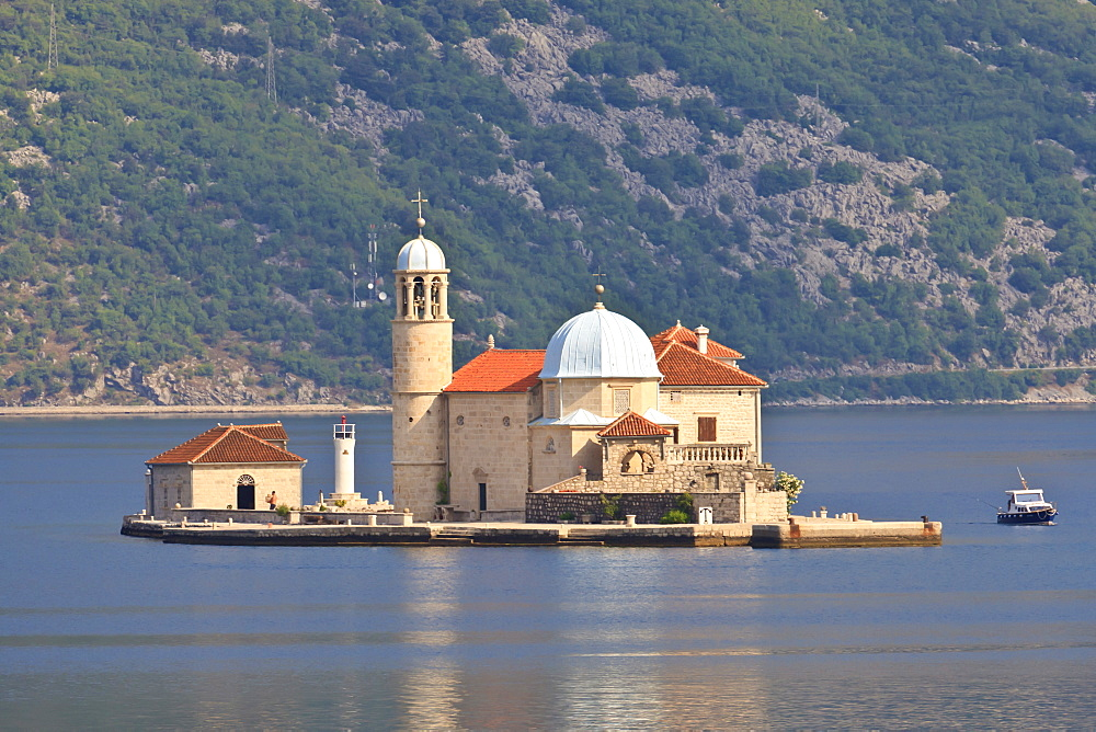Gospa od Skrpjela (Our Lady of the Rocks) island, lit by early morning light, near Perast, Bay of Kotor, Montenegro