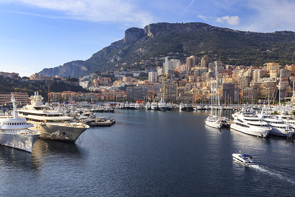 Pastel hues of the glamorous harbour of Monaco (Port Hercules) with many yachts, viewed from the sea, Monte Carlo, Monaco, Cote d'Azur, Mediterranean, Europe