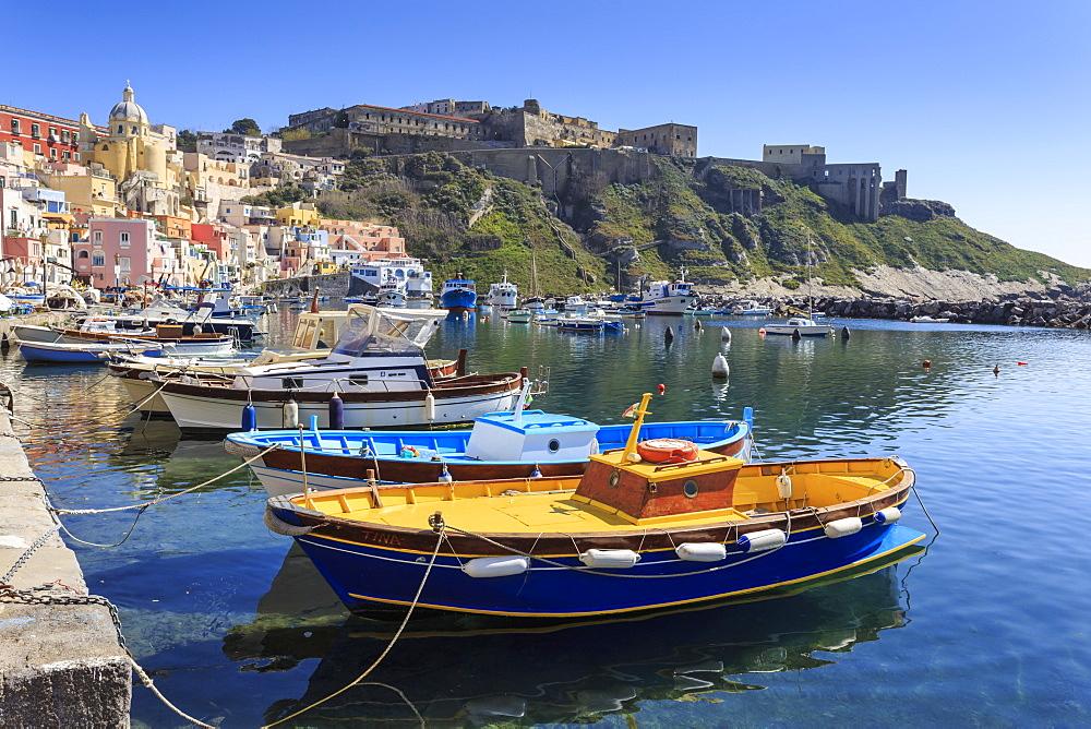 Marina Corricella, pretty fishing village, colourful houses, boats and Terra Murata, Procida Island, Bay of Naples, Campania, Italy, Europe