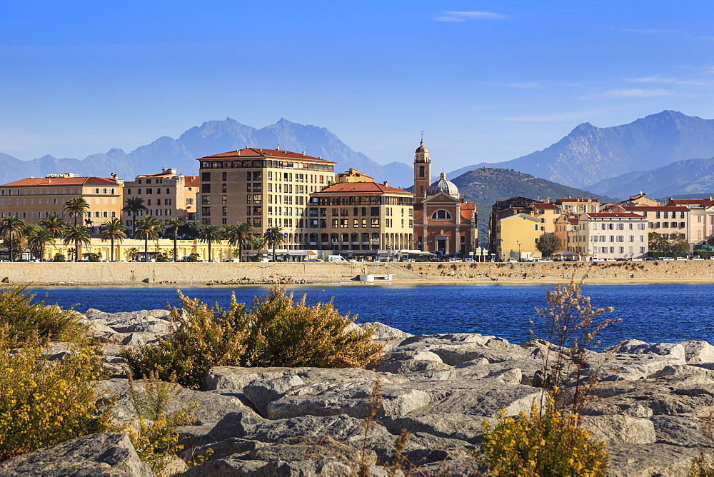 Cathedral, city and hazy mountains, from its rocky waterfont, Ajaccio, Island of Corsica, Mediterranean, France, Mediterranean, Europe