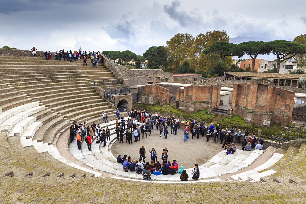 Tour groups in the Large (Grand) Theatre, Roman ruins of Pompeii, UNESCO World Heritage Site, Campania, Italy, Europe