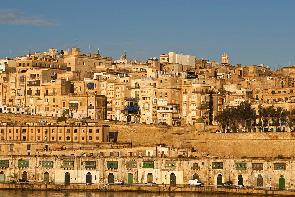 View of the old town from the Grand Harbour in the golden early morning, Valletta, Malta, Europe