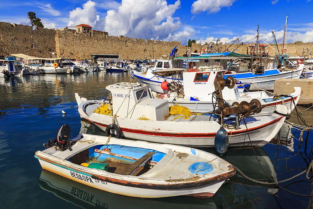 Fishing boats, Commercial harbour and Medieval walls, Old Rhodes Town, UNESCO World Heritage Site, Rhodes, Dodecanese, Greece