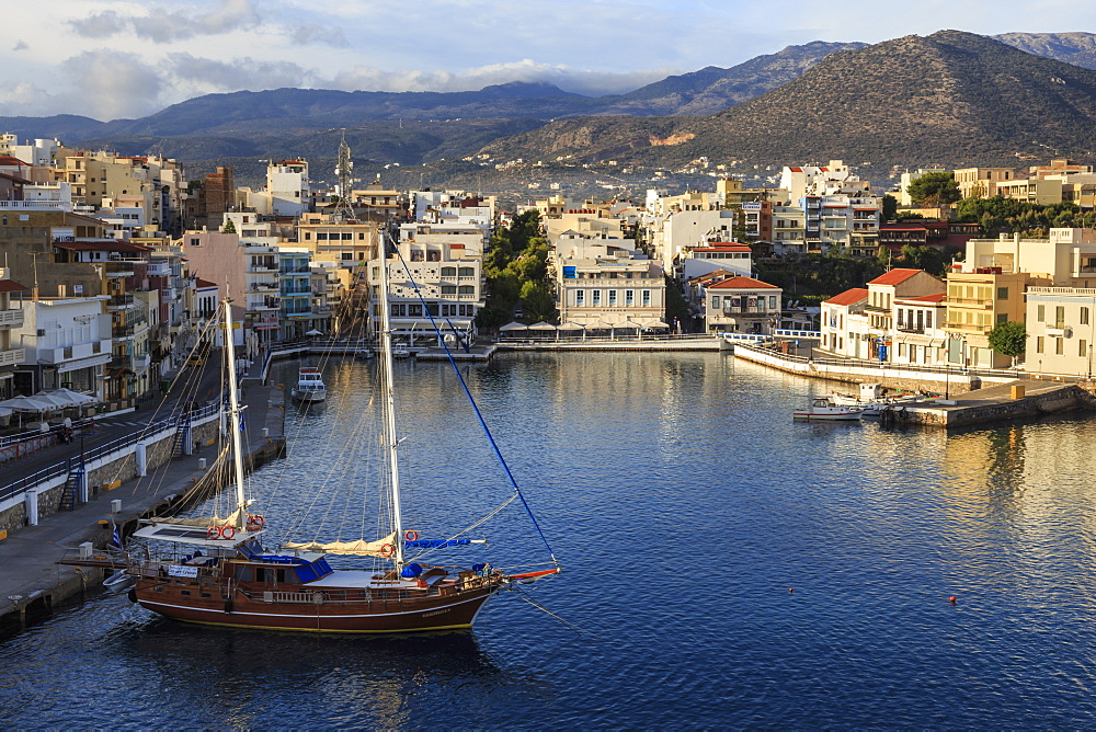 Attractive harbour and town backed by mountains, from Mirabello Bay, Agios Nikolaos, Lasithi, Crete, Greek Islands, Greece, Europe - 1167-1488