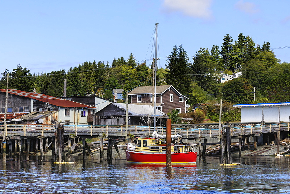 Red yacht, old dock buildings and jetty, Alert Bay, Cormorant Island, Vancouver Island, Inside Passage, British Columbia, Canada, North America