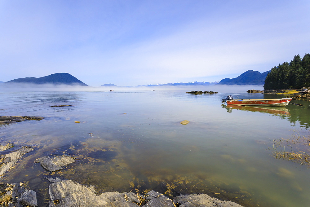 Jet-boats head for the Stikine River, mist clears from beautiful Petroglyph Beach, State Historic Park, Wrangell, Alaska, USA