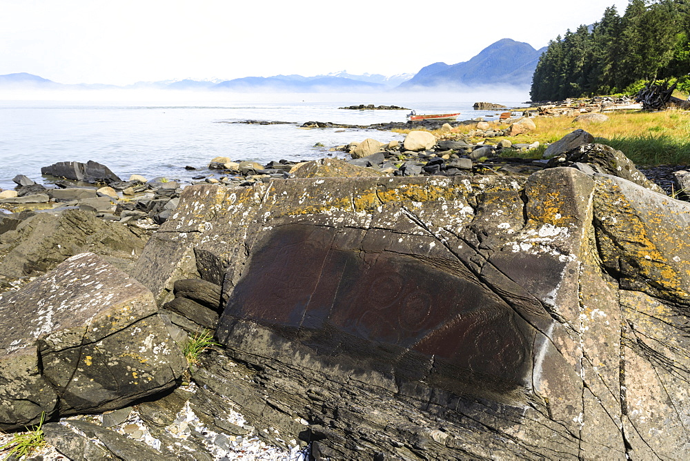 Petroglyphs with mist clearing from beautiful Petroglyph Beach, State Historic Park, Wrangell, Inside Passage, Alaska, USA