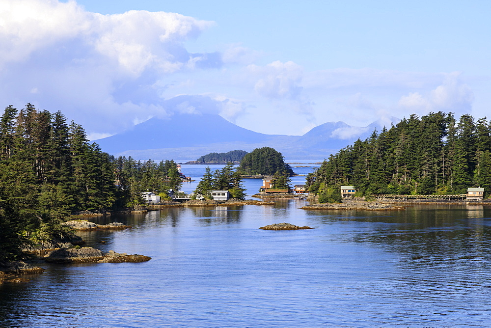 Wooden houses on small forested islands, clearing morning mists, Sitka Sound, Sitka, Northern Panhandle, Southeast Alaska, USA