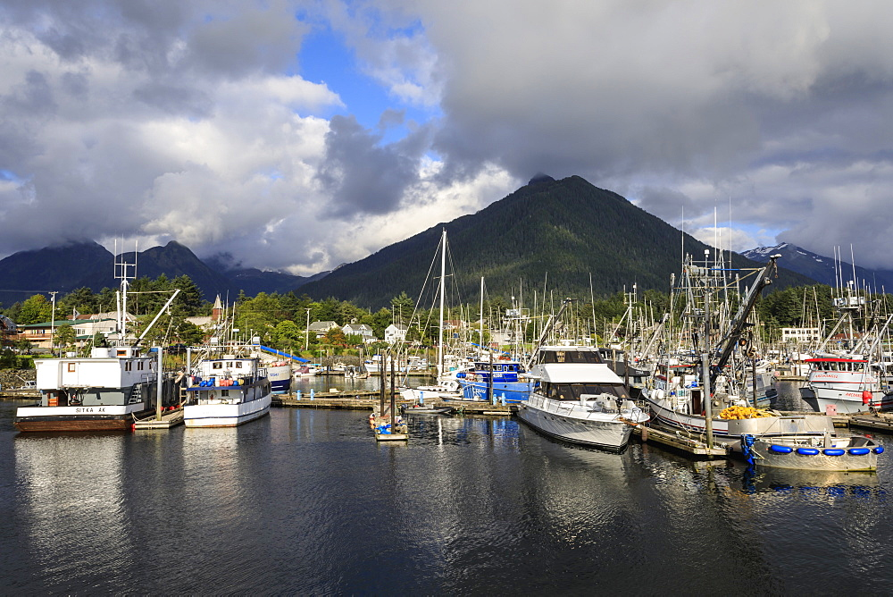 Crescent Boat harbour with beautiful wooded mountains and town of Sitka, rare sunny day, summer, Baranof Island, Alaska, United States of America, North America