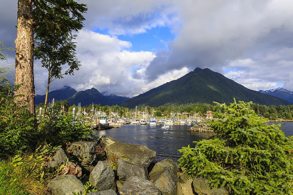 Crescent Boat harbour with beautiful wooded mountains and town of Sitka, rare sunny day, Summer, Baranof Island, Alaska, USA