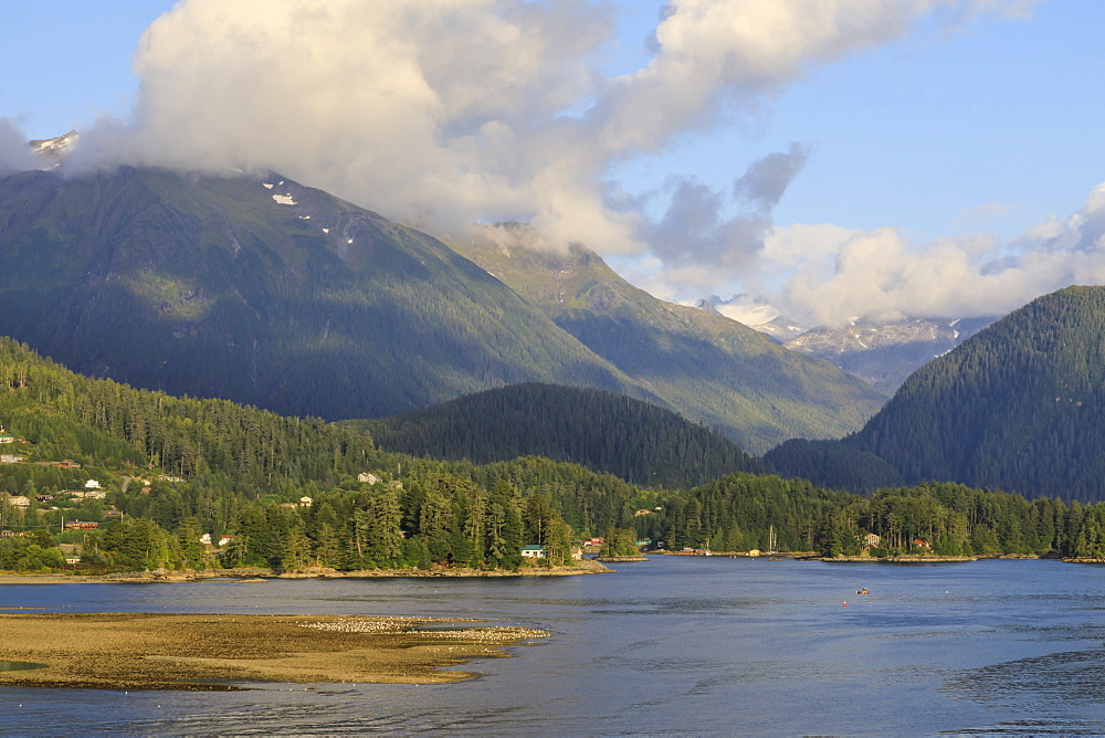 Forested mountains and wooden houses, from Sitka Sound, rare evening sun, Summer, Sitka, Northern Panhandle, Alaska, USA