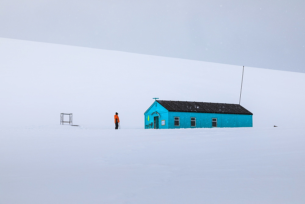 Damoy Hut, expedition ship visitor in the snow, Historic Monument, Dorian Bay, Wiencke Island, Antarctic Peninsula, Antarctica, Polar Regions