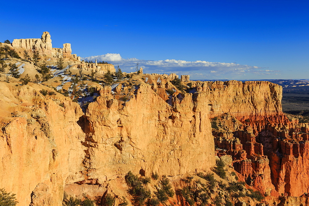 Cliffs and hoodoos lit by late afternoon sun in winter, Paria View, Bryce Canyon National Park, Utah, United States of America, North America