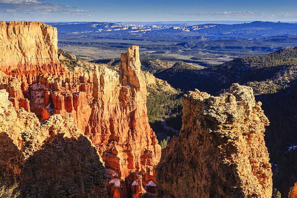 Cliffs and hoodoos lit by late afternoon sun with distant view in winter, Paria View, Bryce Canyon National Park, Utah, United States of America, North America