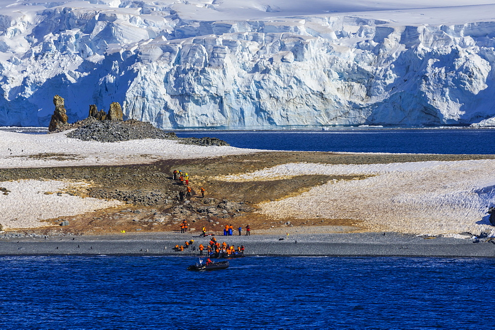 Expedition tourists leave Half Moon Island, Livingston Island blue glaciers and evening sun, South Shetland Islands, Antarctica, Polar Regions