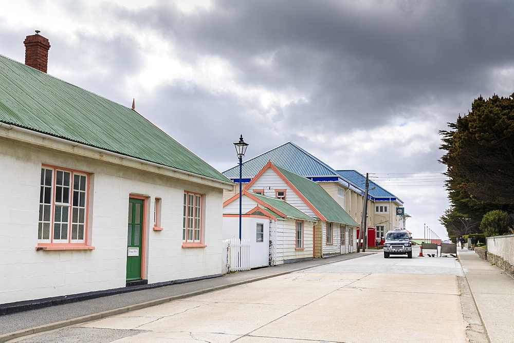 Traditional buildings with pastel iron roofs, Post Office, phone boxes, taxi, Central Stanley, Port Stanley, Falkland Islands, South America