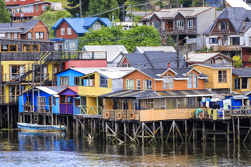 Palafitos, colourful stilt houses on water's edge, elevated view, unique to Chiloe, Castro, Isla Grande de Chiloe, Chile, South America