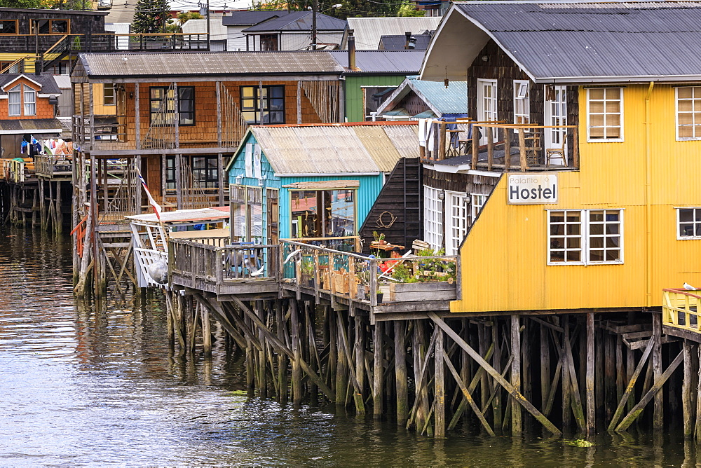 Palafitos, colourful stilt houses on water's edge, unique to Chiloe, Castro, Isla Grande de Chiloe, Chile, South America