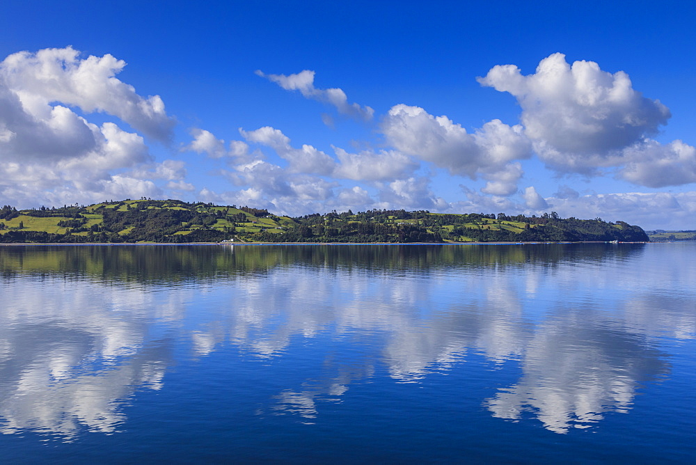 Castro inlet reflections, rural scene, fluffy clouds and rolling hills, Isla Grande de Chiloe, Chilean Lake District, Chile, South America - 1167-1875