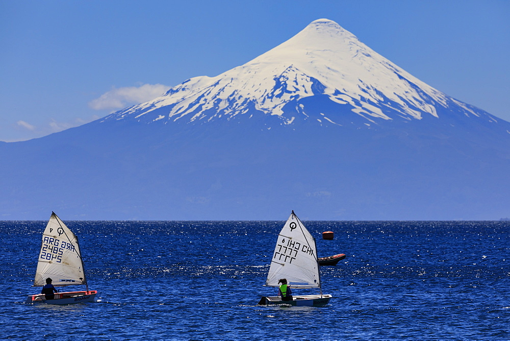 Sailing on Lake Llanquihue, snow-capped Orsono volcano, from Puerto Varas, Lakes District, Chile, South America